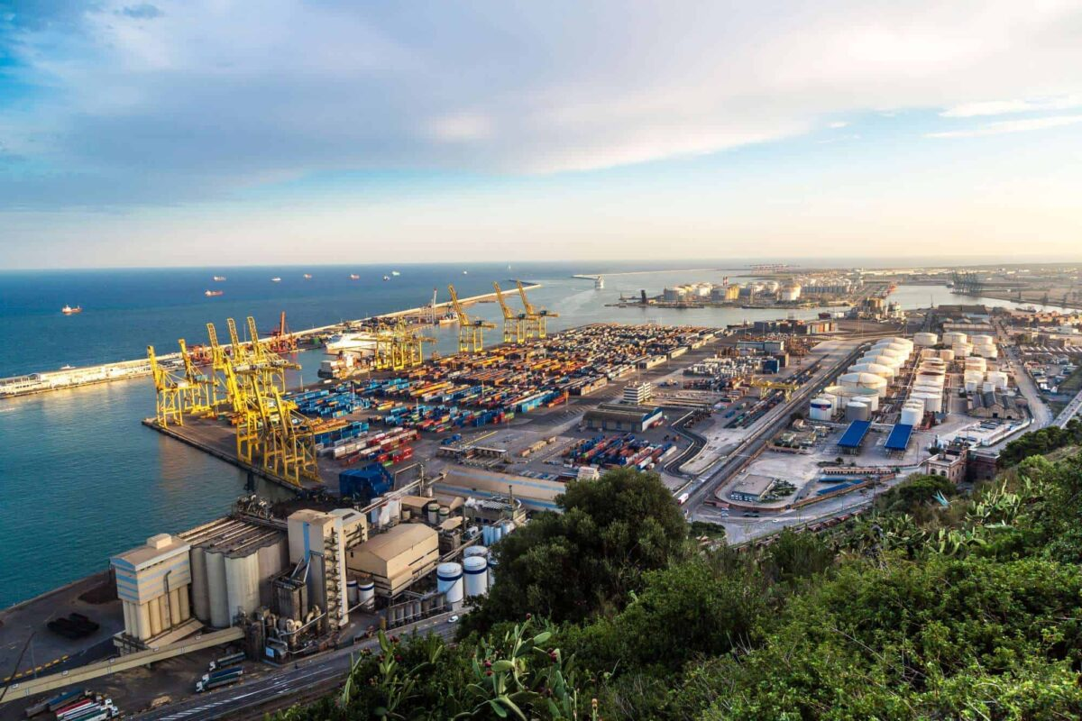 Panoramic view of the port in Barcelona: shipping containers and loading bays. Removals to Spain