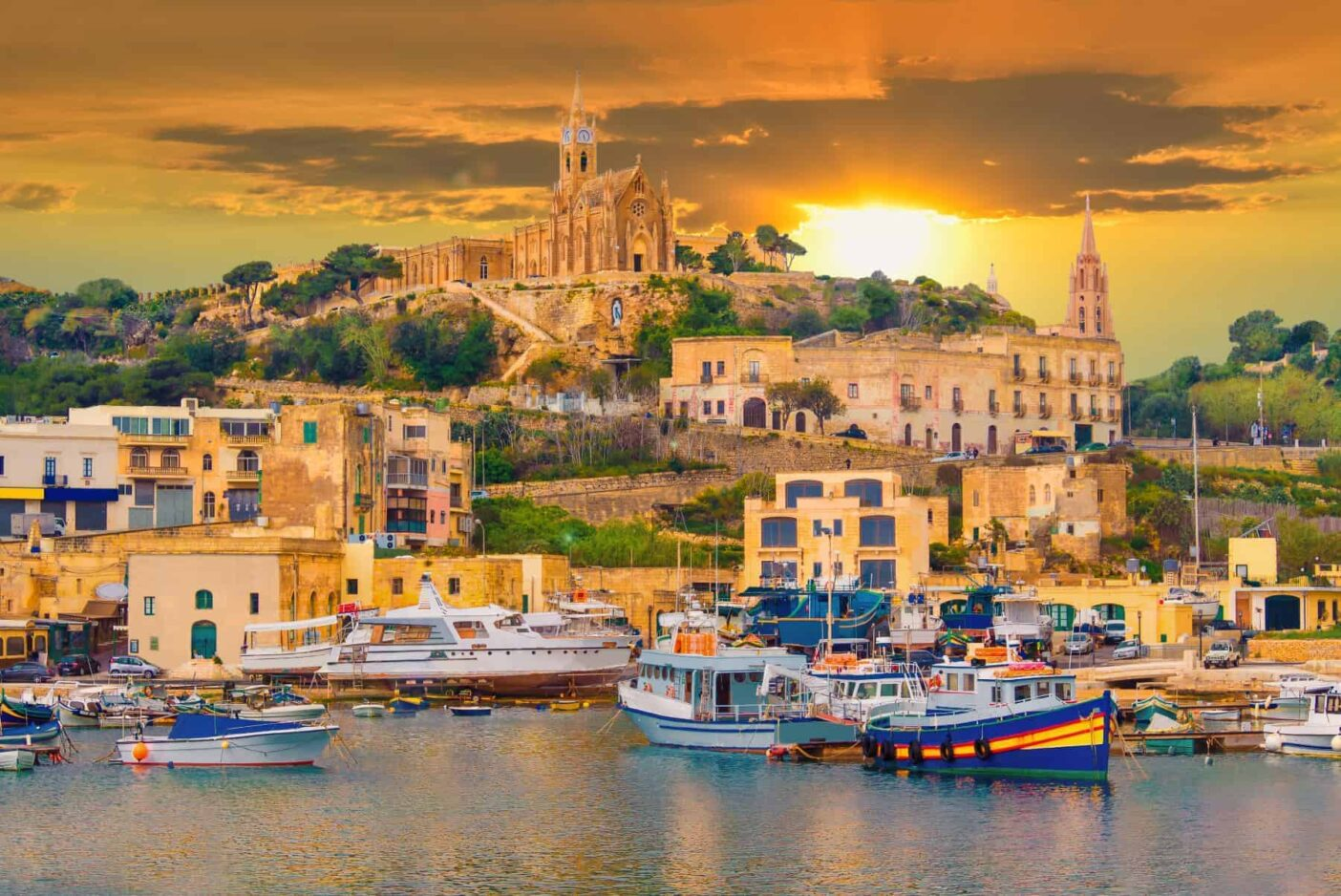 Gozo island, medieval architecture of castle and boats on the harbor of Malta