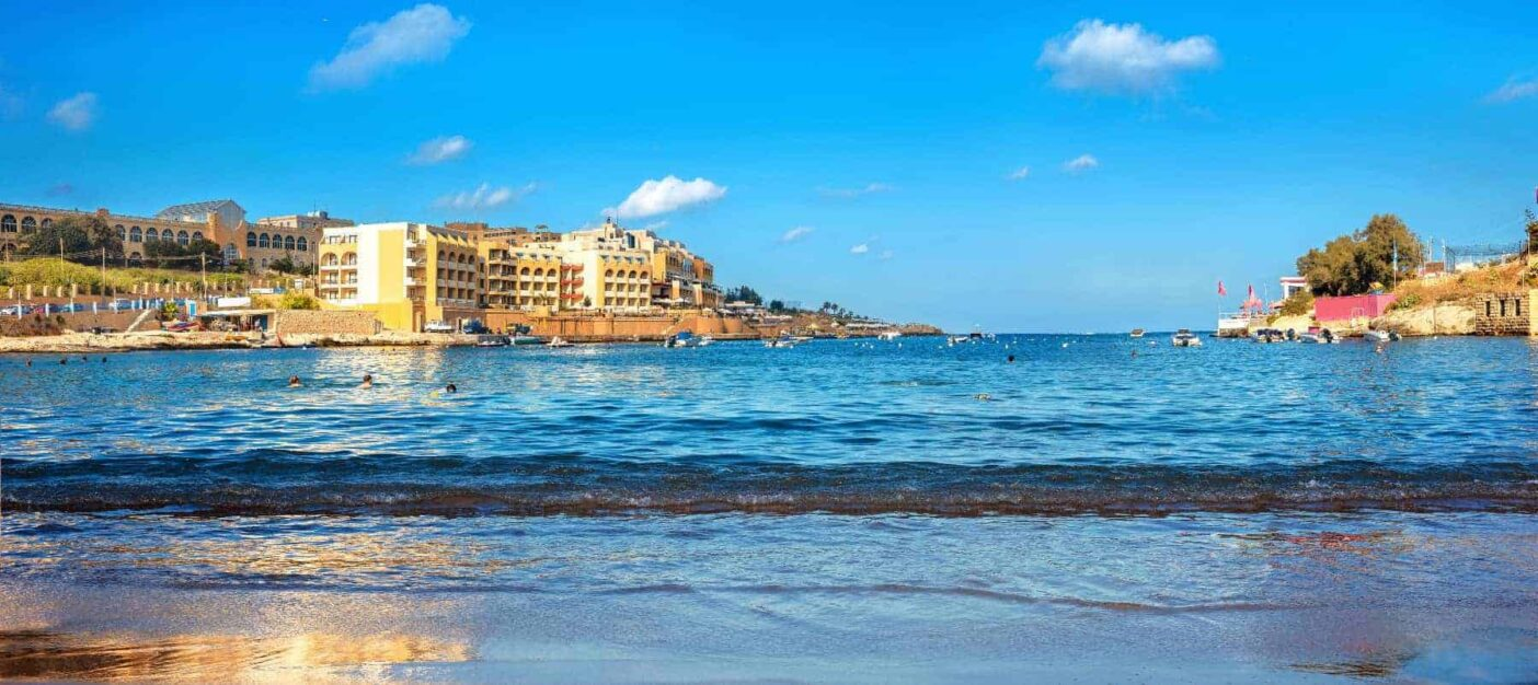 Panoramic view from beach of St. Georges bay. Pembroke, Malta